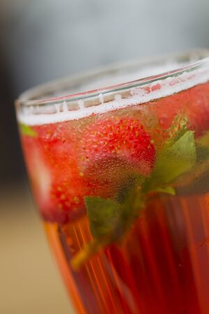 countertops: Cold lemonade with strawberries, mint and ice on the outdoor veranda summer day, sunlight.