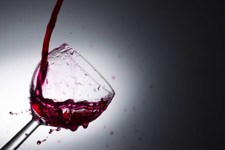 pours: Wine pouring into a glass, studio lighting, Macro