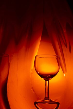 wine glasses: Wine glass on an abstract colored background, studio lighting