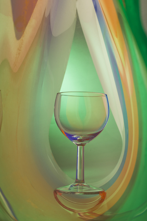 still life of wine: Wine glass on an abstract colored background, studio lighting