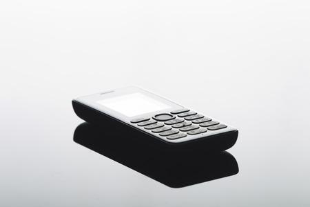 advances: Cell phone on a uniform gradient background, studio lighting