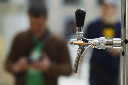 Bright metal beer tap, natural light, sunlight