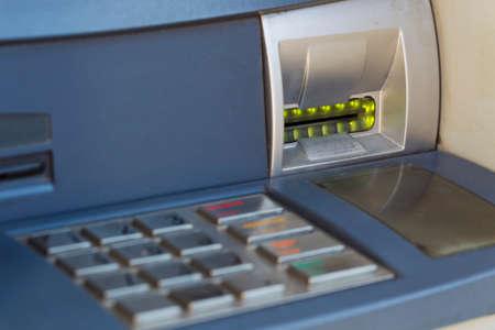 luz natural: ATM para la distribuci�n de dinero en efectivo, la luz natural, Macro Foto de archivo