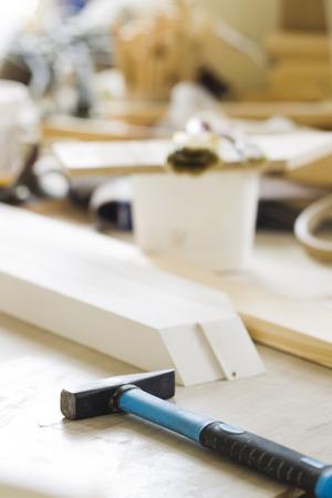 carpenter's bench: Hammer lying on the desktop, natural light Stock Photo