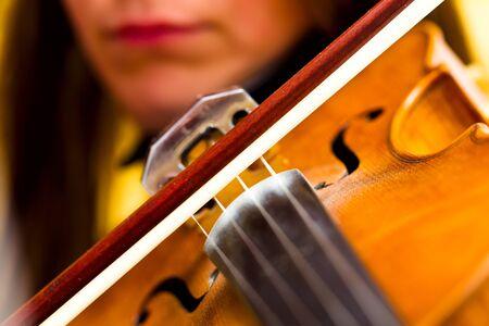 Girl playing the violin classical music, detail, Macro, studio lighting