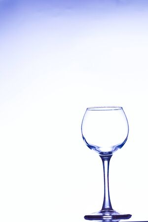 Wine pouring from a bottle into a glass, studio lighting Stock Photo