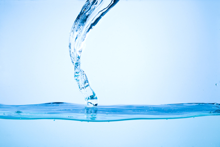 water flowing: Flowing water, drops, sprays, splashes on a neutral background Stock Photo