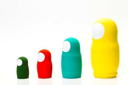 Wooden multi-colored toy nuts on white background, studio light Stock Photo