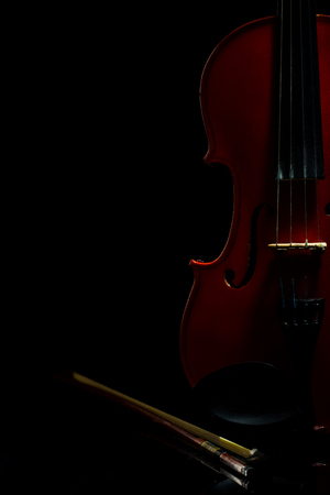 Violin, notes, bow on a black background, still life, studio light
