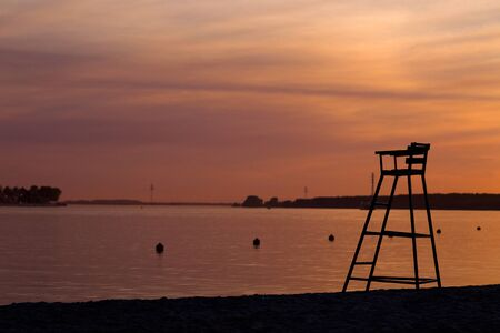 Rescue tower on a river beach against a summer sunset Stock Photo