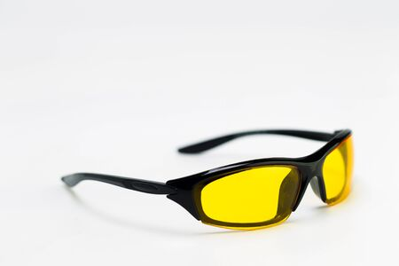 Sunglasses with yellow lenses on a white background, studio light