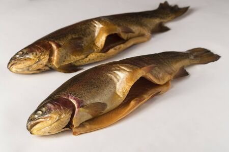Cold smoked fish. River trout, rainbow, golden, lake, Karelian cold smoked on a white background