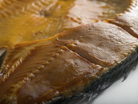 Delicacy. Cold smoked golden carp. Cold smoked fish. Studio light