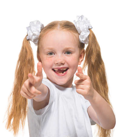 Little red-haired girl on an isolated background, white, studio light