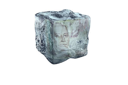 Frozen Ukrenian money in ice cube, isolate on a white background