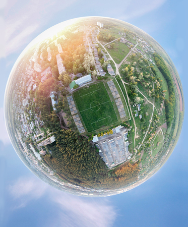 Football planet. Concept with a panorama around the soccer stadium. Imagens