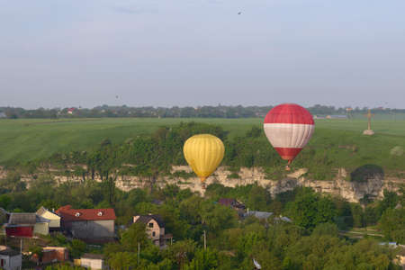 Hot air balloons over the beautiful old town