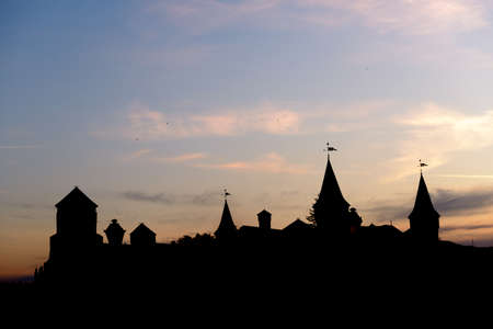Silhouette of a old medieval fortress against the sky