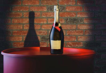 Bottle of champagne on a big red barrel