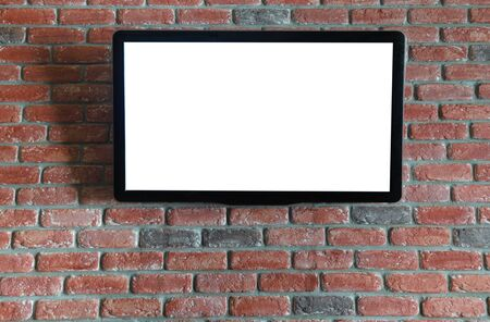 TV on the red brick wall with isolated screen Imagens