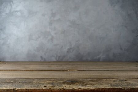 Empty table top on concrete wall background