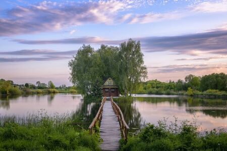 Fisherman's house on the island among the river Imagens