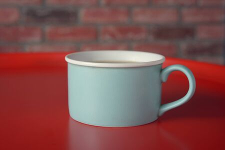 Big Blue Cup of coffee on the wall background