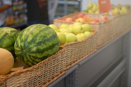 Different types of fruit at the grocery store counter