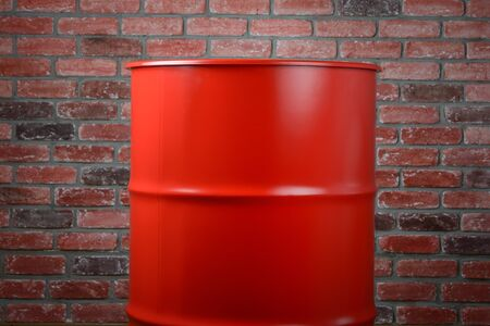 Large Iron Red Barrel on a brick wall background Imagens