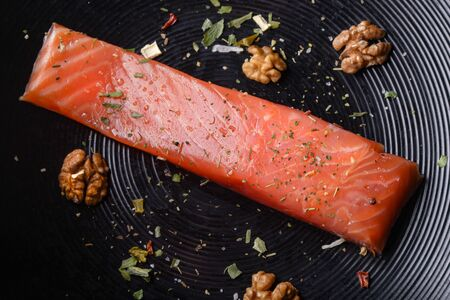 Trout fillet with nuts and spices. Source of omega-3 healthy fats