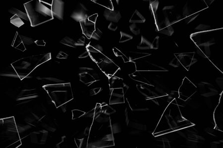 The texture of breaking glass on a black background Imagens