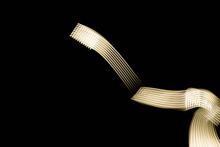 Golden light texture isolated on black background - closeup Imagens