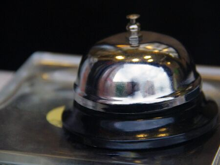 table bell is in the reception at the hotel 免版税图像