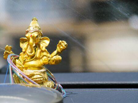 golden ganesh deity wrapped in an optical fiber