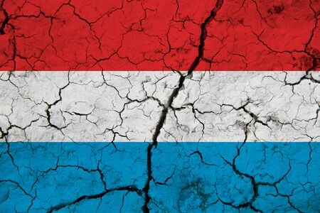 Luxembourg flag on the background texture. Concept for designer solutions.