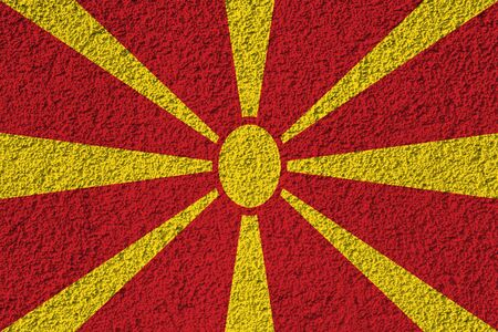 macedonia flag on the background texture. Concept for designer solutions. Stock Photo