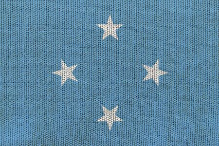 Micronesia flag on the background texture. Concept for designer solutions.