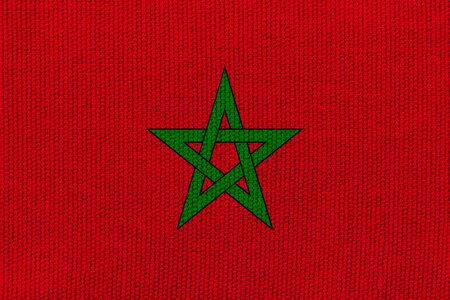 Morocco flag on the background texture. Concept for designer solutions.