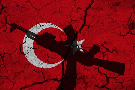 Hand assault rifle on the background  flag of Turkey and cracks. Turkey Power Concept.