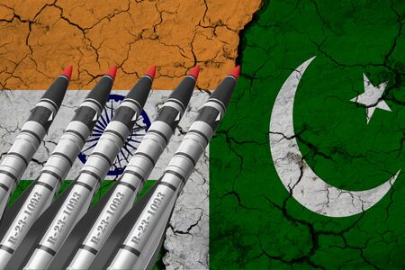 A closeup view of the flag of India and the flag of Pakistan against a background of cracked earth. The concept of the crisis of war and the confrontation between India and Pakistan.