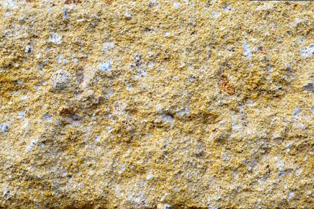 Backgrounds and textures. Macro shot of a yellow brick texture.