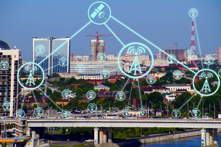 IOT, Internet smart city and network connect Wi-Fi access points. Background and Wi-Fi icons on the background of the city.