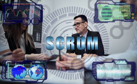 Group of business people in modern office engaged in planning, generating ideas. Futuristic holographic screen on graphs of exchange rates, a fingerprint scanner and the inscription: SCRUM 스톡 콘텐츠