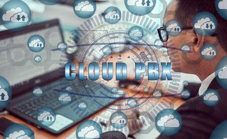 Cloud storage icons flying from the center. Hands of a businessman using a laptop with a smartphone and the inscription: CLOUD PBX