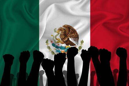 Silhouette of raised arms and clenched fists on the background of the flag of Mexico. The concept of power, power, conflict. With place for your text.