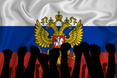 Silhouette of raised arms and clenched fists on the background of the flag of Russia. The concept of power, power, conflict. With place for your text.