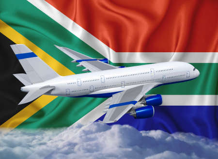 South Africa flag with white airplane and clouds. The concept of tourist international passenger transportation. Stock Photo