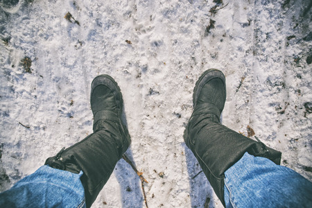 Guy's legs in modern boots on snow