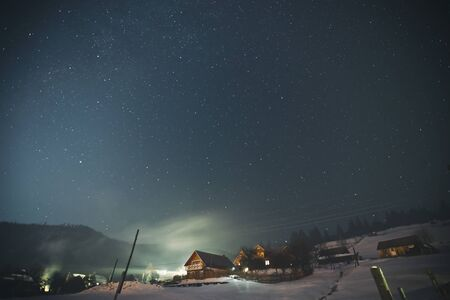 Beautiful starry night in the village in the mountains