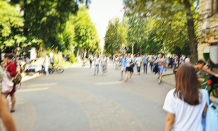 Lots of people are walking in the park